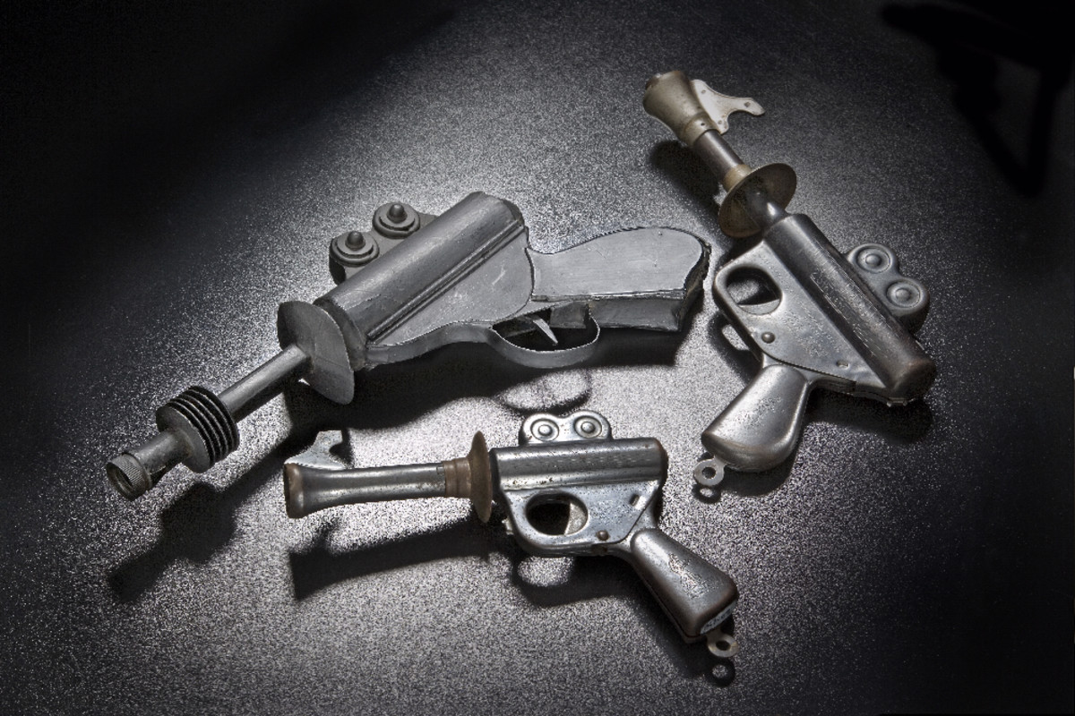 """Likely an influence for the designer of the ice gun: the Buck Rogers XZ-31 Rocket Pistol by Daisy Manufacturing. From top left, clockwise, the prototype for the XZ-31, the XZ-31 itself, and the XZ-35 """"Wilma Deering"""" Rocket Pistol of 1935. The XZ-31 caused a Christmastime sensation when it came out."""