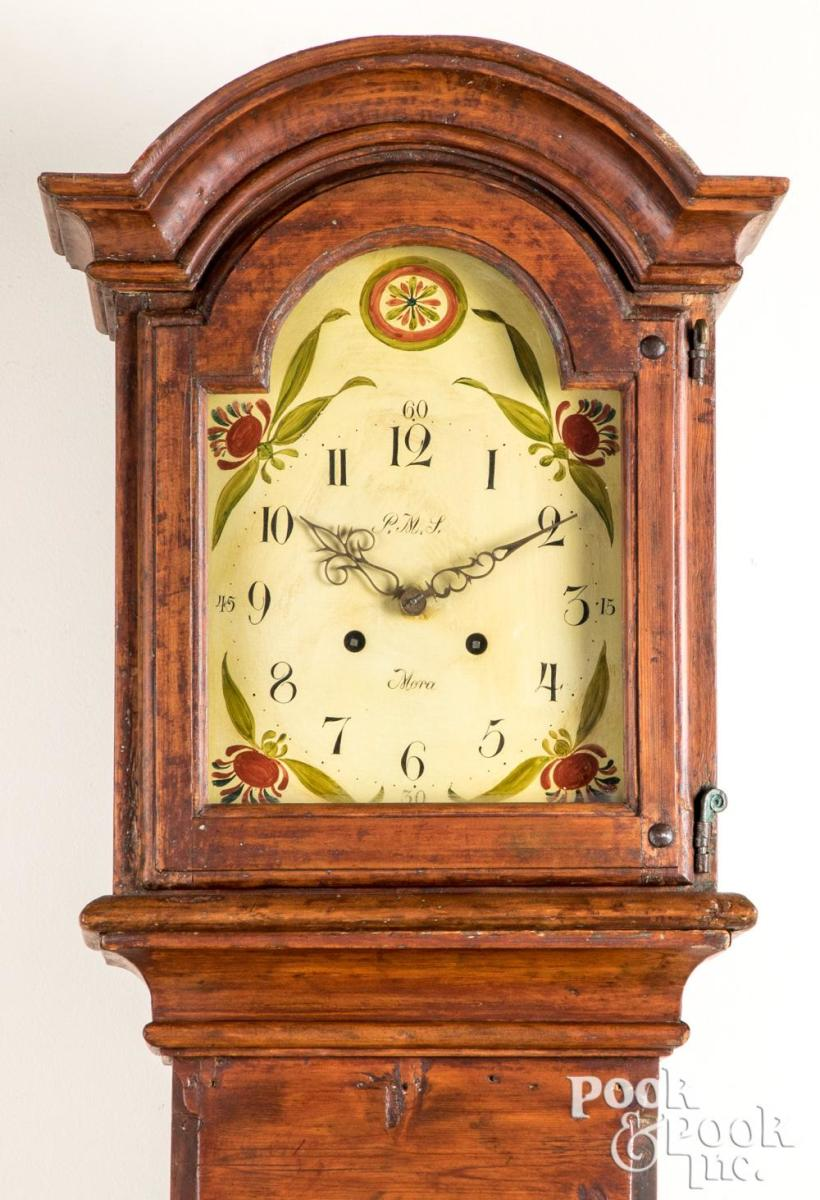 """Scandinavian painted tall case clock, 19th c., the face signed Mora, 88-1/4"""" h; estimate: $500-$800."""