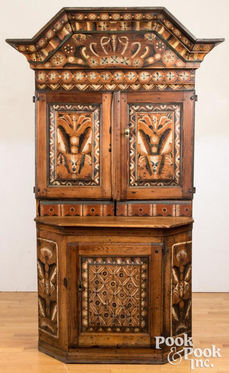 "Scandinavian painted pine cupboard, dated 1796, retaining its original decoration, 79"" h, 36 3/4"" w; estimate: $500-$1,000."
