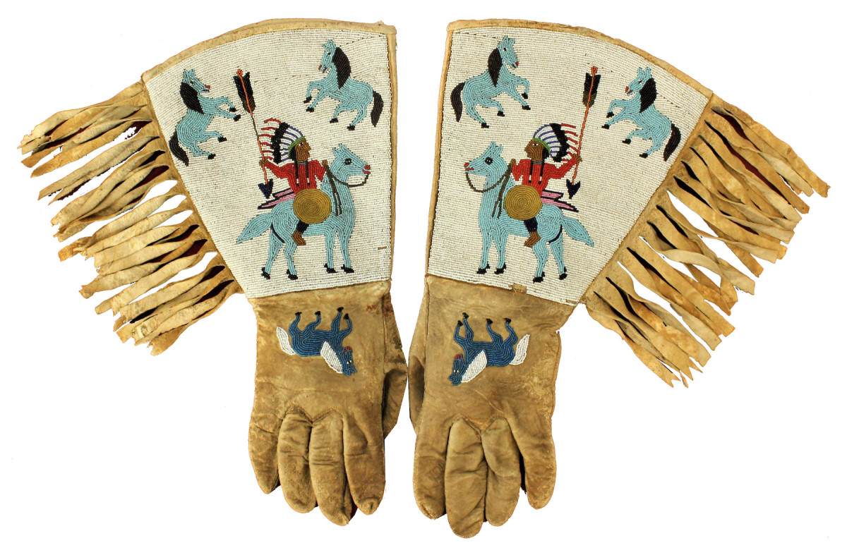 Turn-of-the-century Native American (Plateau)  gauntlets, fully beaded  with images of multiple  figures, including Indian  chiefs and horse. Estimate: $4,500-$7,500.
