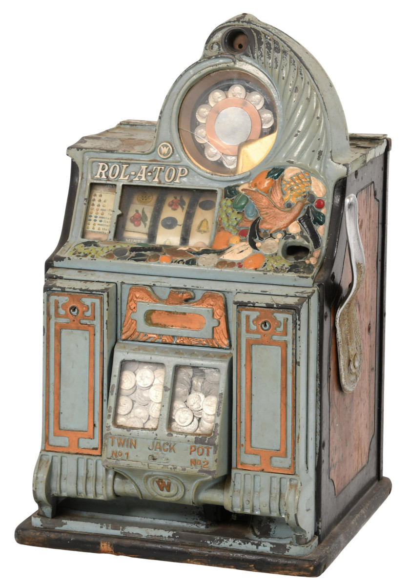 """Watling 25 Cent  """"Roll-A-Top"""" slot machine, early 20th century, 25-1/2"""" x 16"""" x 15""""; est: $1,200-$1,500."""