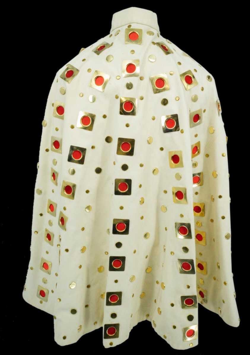 The eyelet jumpsuit's matching cape; estimate: $150,000-$200,000.