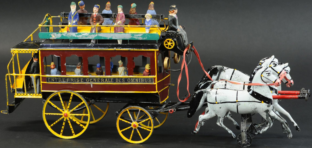 Large hand-painted French omnibus, 24-inches long with cast-lead wheels and original plaster passenger figures, ca. 1895. Estimate: $6,000-$9,000.