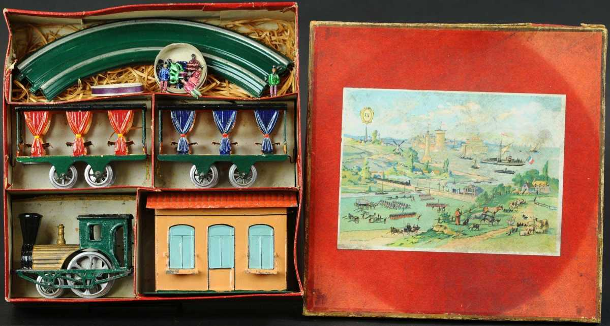 """Boxed FV Summer Train set, O gauge, circa 1890, hand-painted wind-up locomotive with summer cars having embossed-tin """"curtains"""" and 12 rare lead passenger figures. Estimate: $3,000-$5,000."""