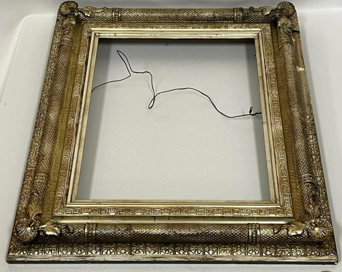 Also being auctioned is this c. 1890 ornate gesso silver gilt and wood picture frame with leaves and florals.