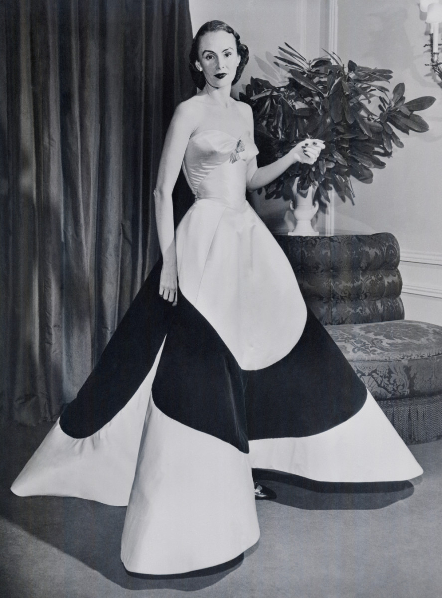 Austine Cassini Hearst wearing her Charles James' Clover Leaf gown at the 1953 March of Dimes fashion show.