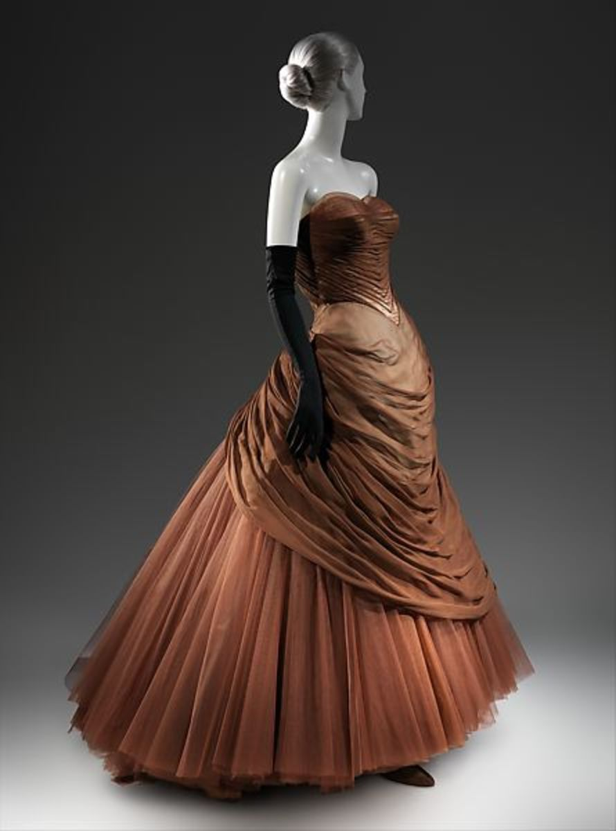 Charles James' Swan gown, 1954, brown silk chiffon, cream silk satin, with a layered understructure of yellow, purple, light brown, and brown nylon tulle.