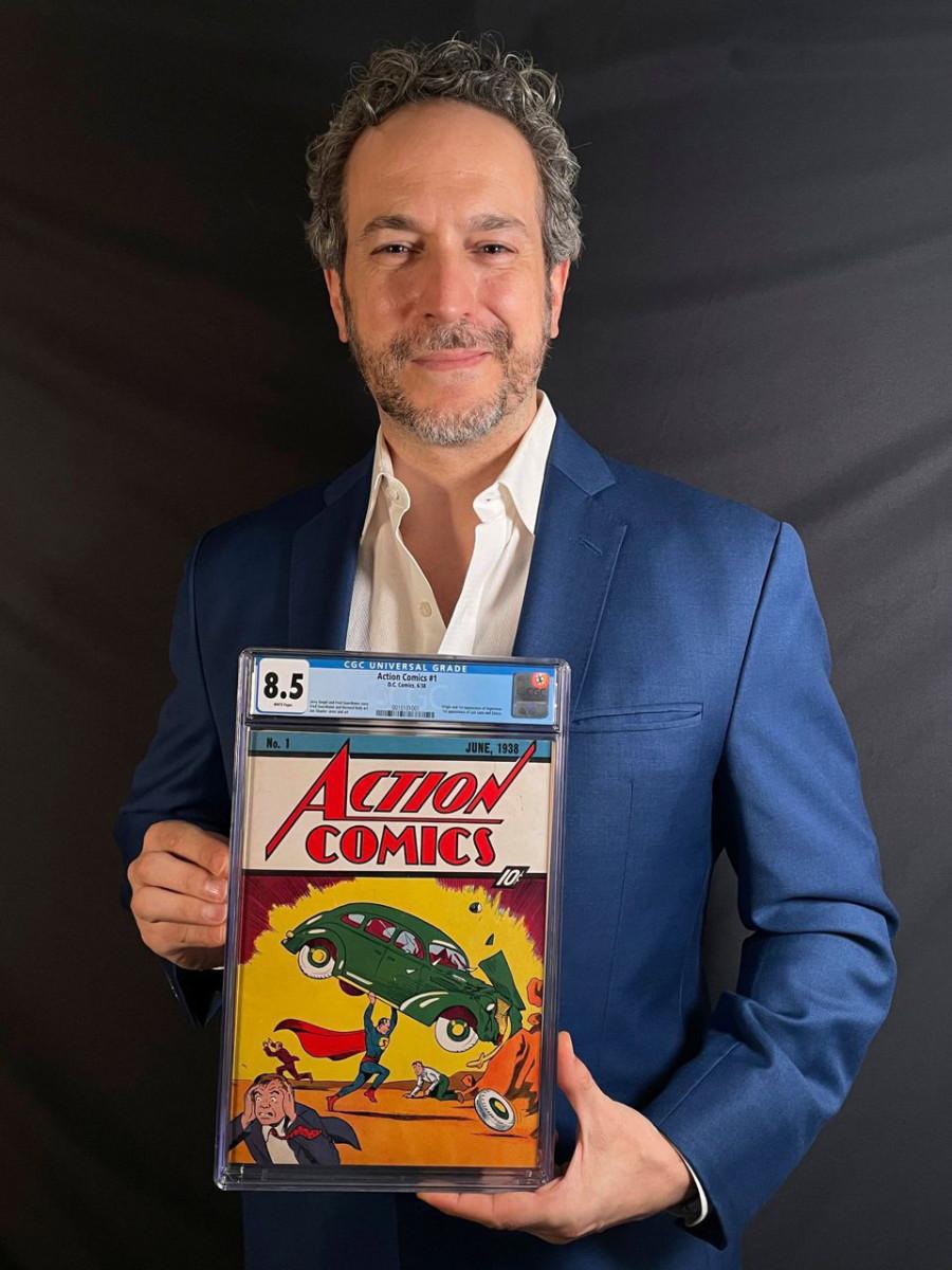 Vincent Zurzolo holding the $3.25-million copy of Action Comics #1.