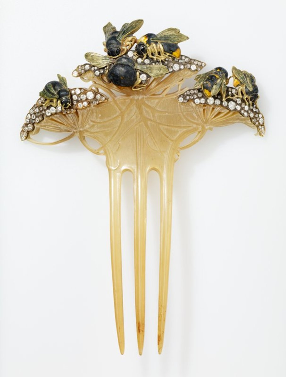 Bees on Flowers: Besides horn, Lalique also experimented with celluloid, from which this comb is made. The comb, 1900, features gold and enamel bees buzzing around diamond-tipped flowers. This piece was ordered in Paris in 1900 by Mrs. Howard Mansfield of New York, and it's likely that she commissioned it while attending the Paris International Exposition.