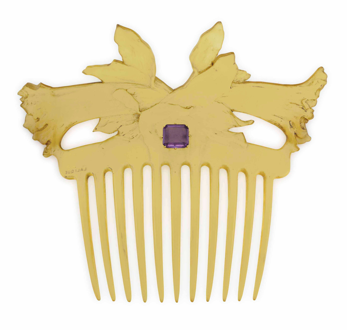 """Flower Blossoms: A carved horn hair comb depicting flower blossoms and centering on a rectangular-cut amethyst, circa 1900, 4-3/4"""" x 4"""". This was from the collection of Peggy and David Rockefeller and sold in 2018 at Christie's for $6,875."""